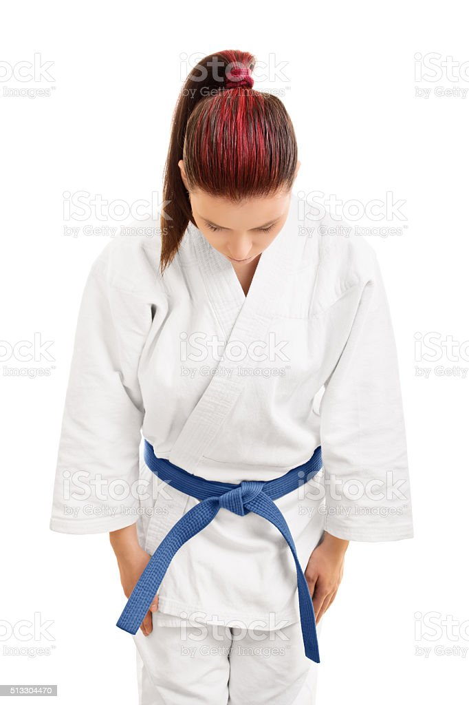 Young girl in a kimono bowing stock photo