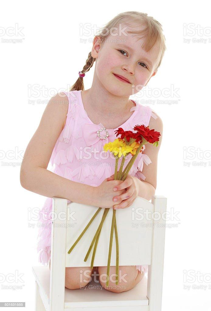Jeune fille dans une robe rose photo libre de droits