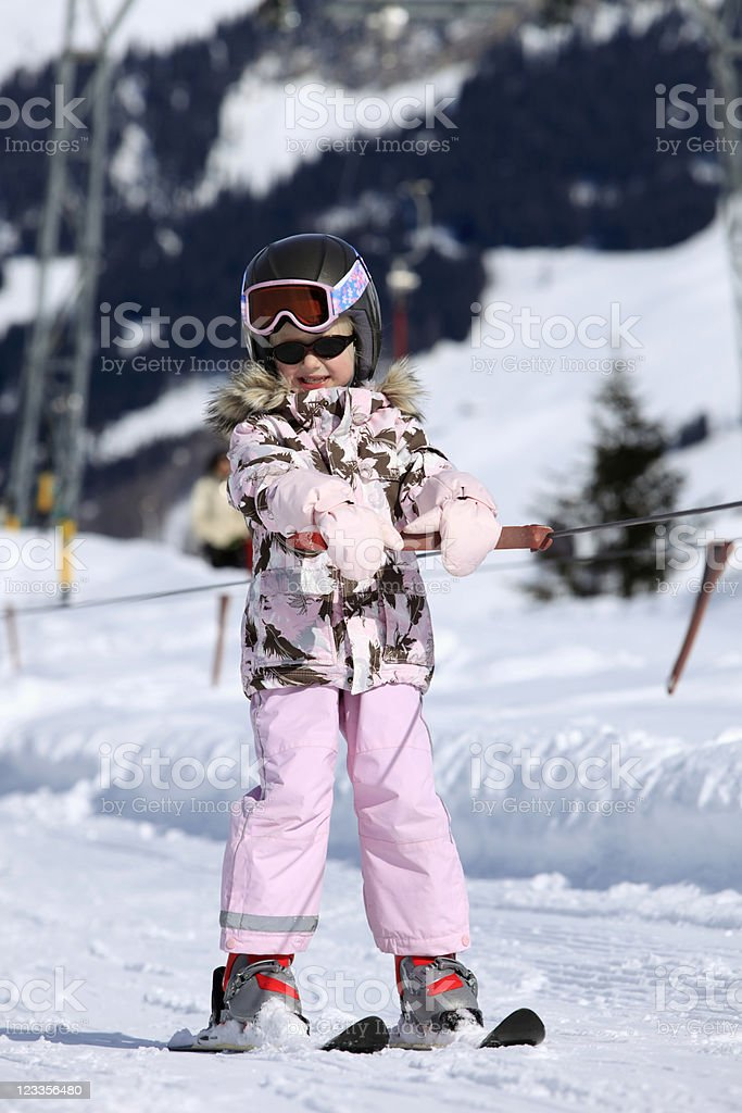 young girl in a ski lift stock photo