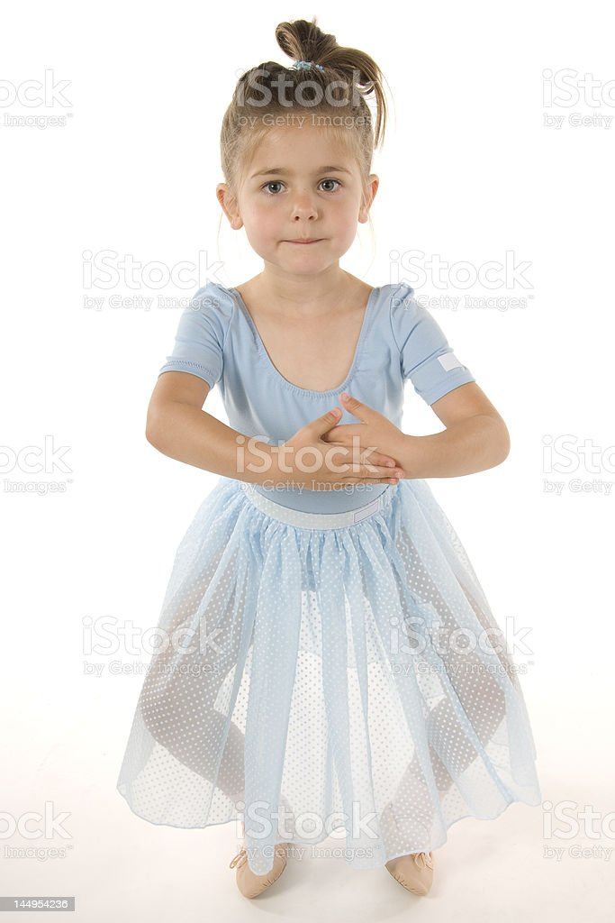 Young girl in Ballet pose isolated white royalty-free stock photo