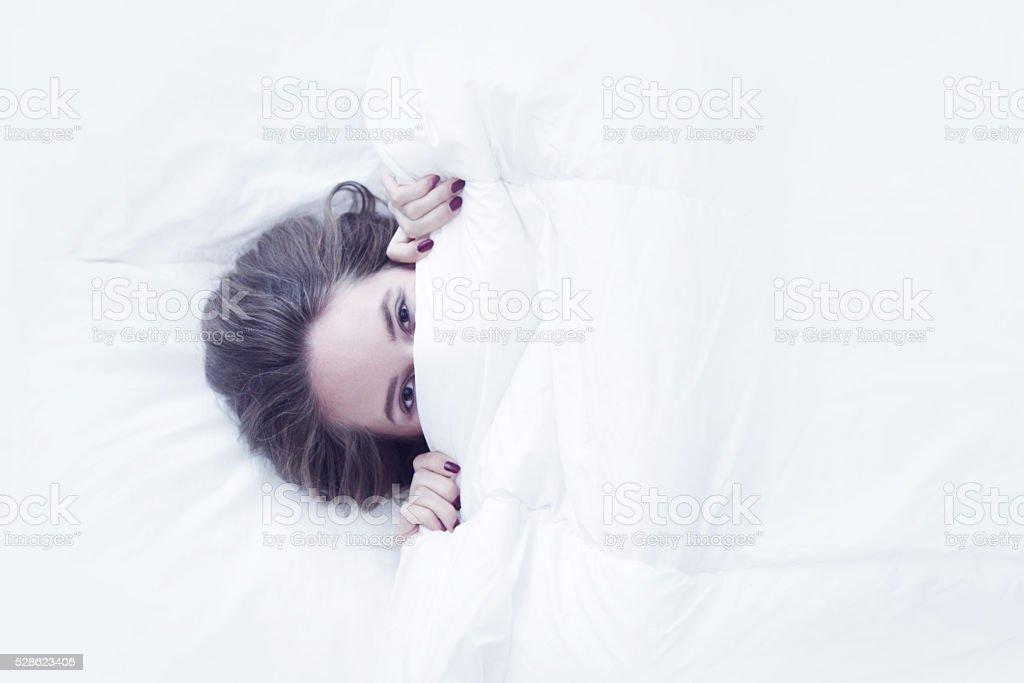 Young girl in bed stock photo