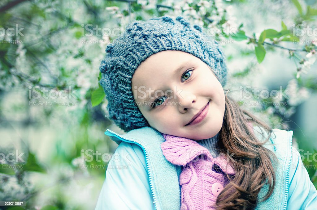 Young girl in blooming cherry garden stock photo