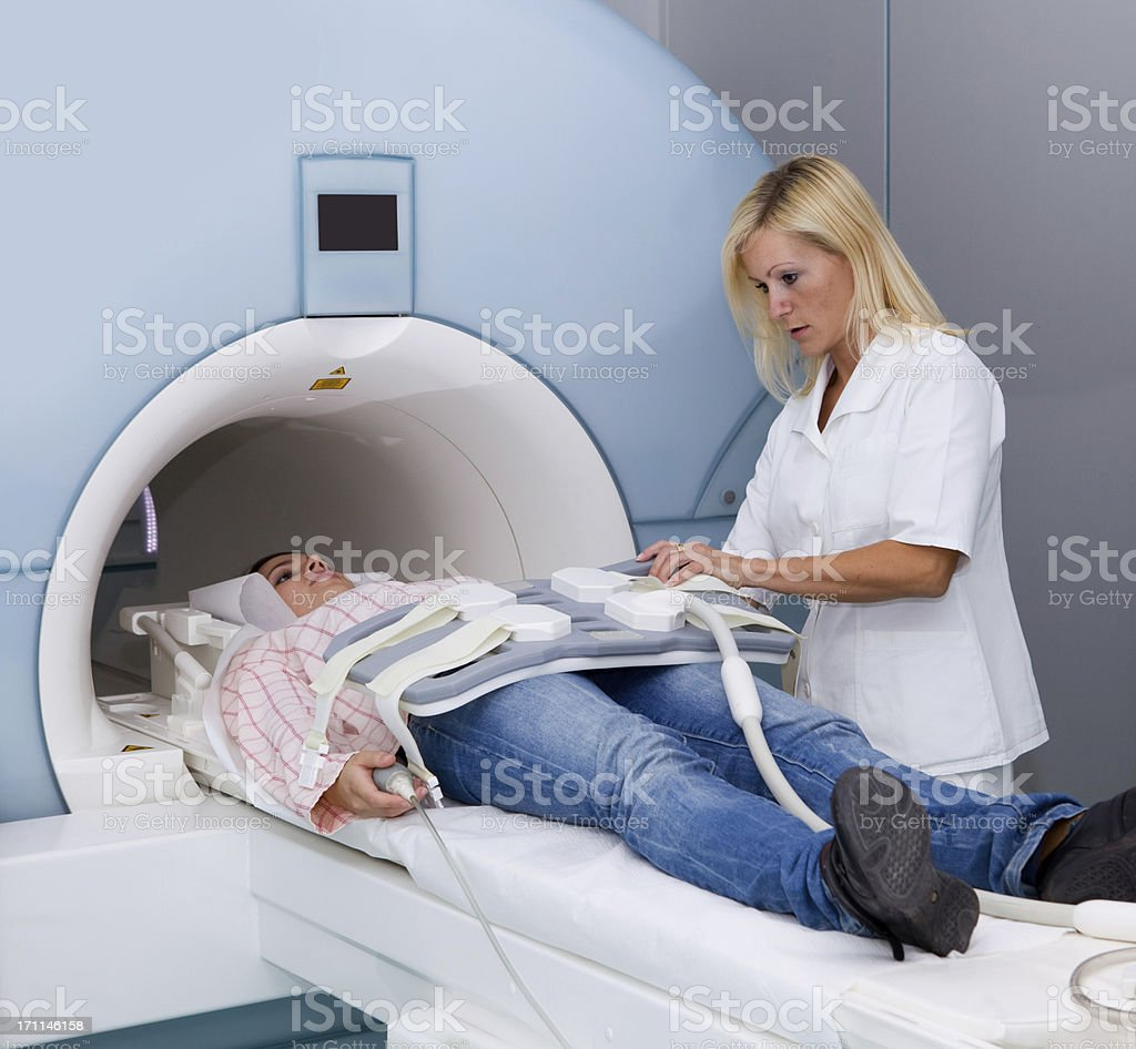 Young girl in CAT scan machine..technician at work royalty-free stock photo