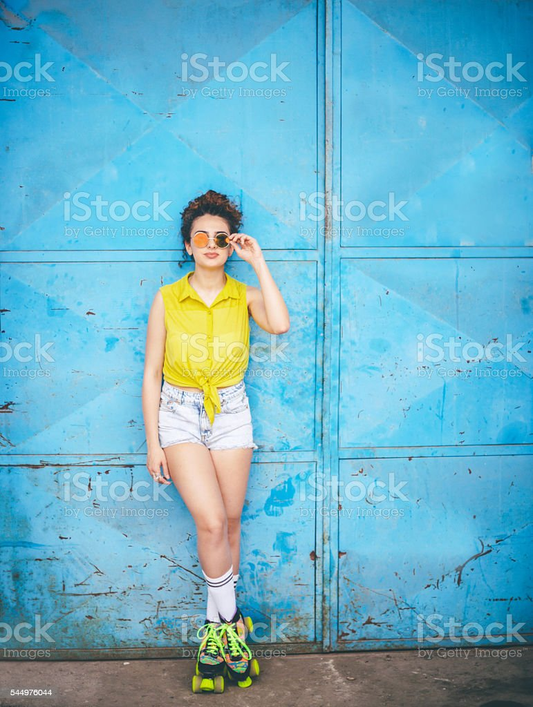 Young girl in colorful roller skates stock photo