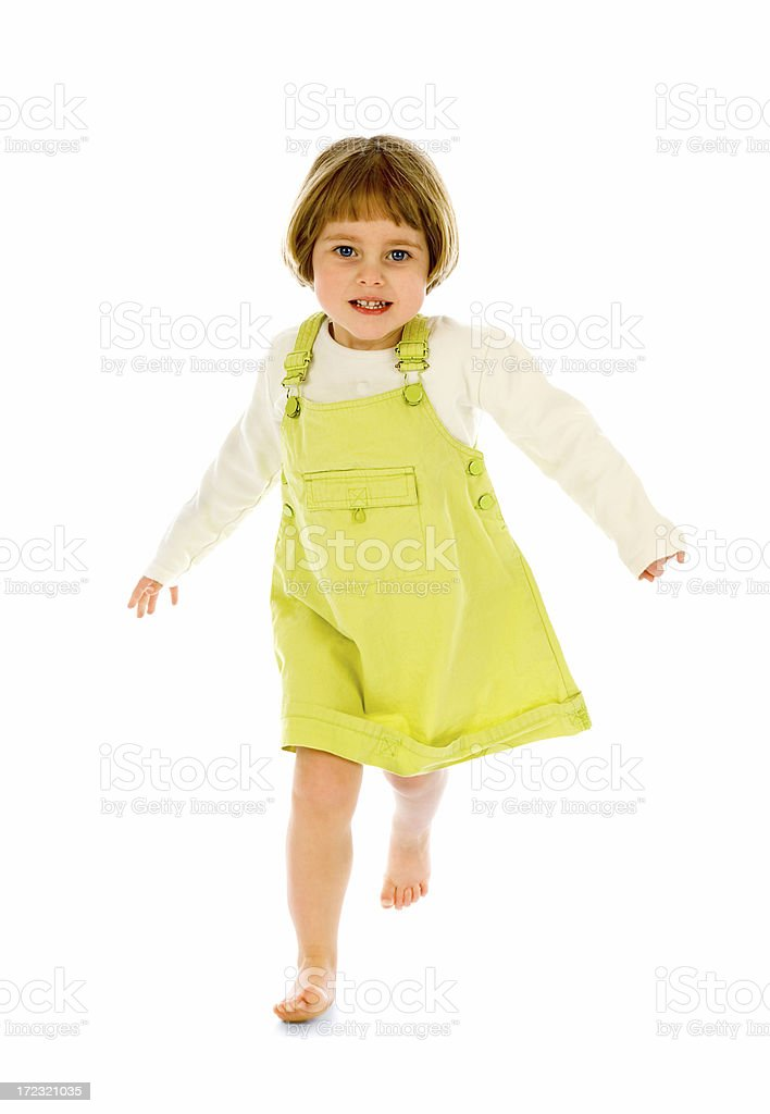 Young girl in dress running towards camera on white royalty-free stock photo
