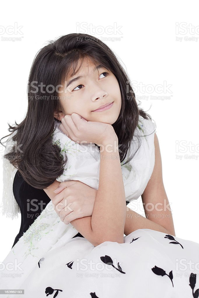 Young girl in elegant dress looking up thinking royalty-free stock photo