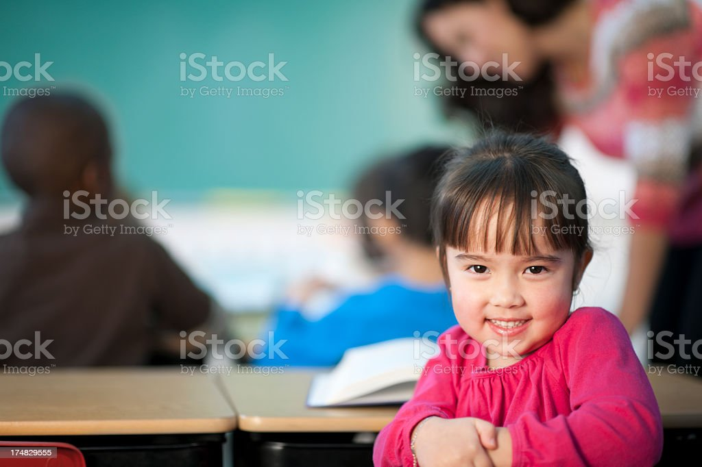 Young girl in elementary class stock photo