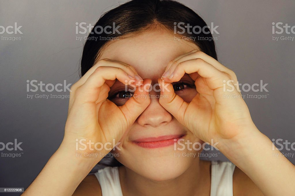 Young girl in glasses and text Snellena.. stock photo