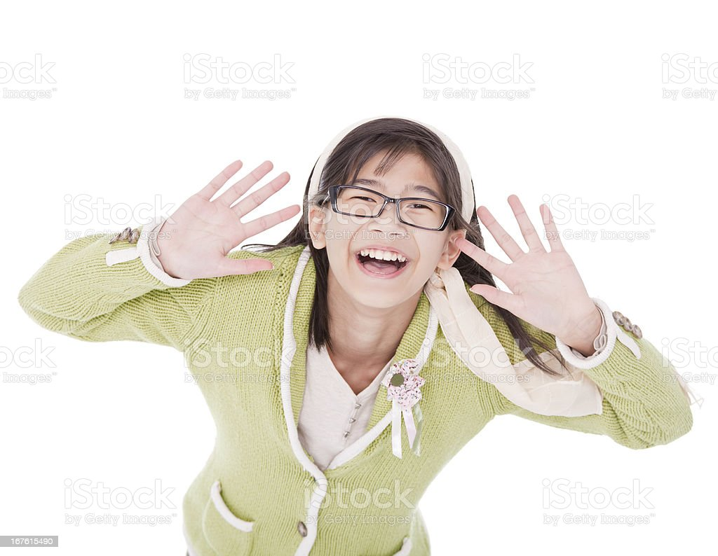 Young girl in green sweater and glasses hands around face royalty-free stock photo