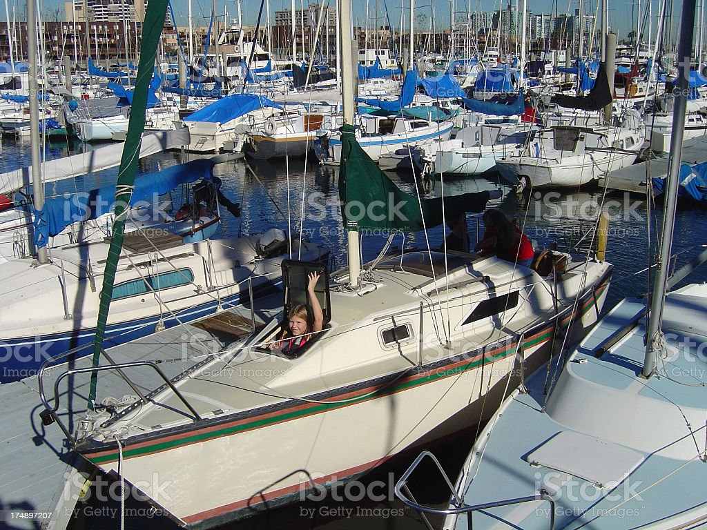 Young Girl in Hatch Open Large Marina royalty-free stock photo