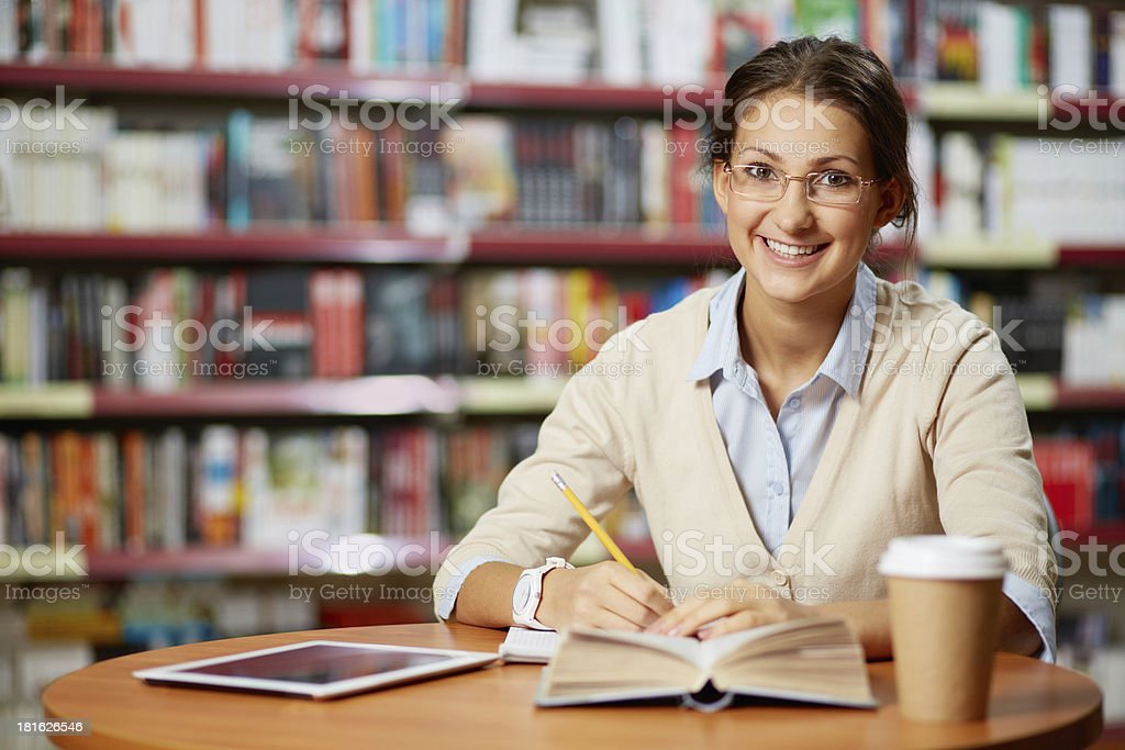 Young girl in library royalty-free stock photo