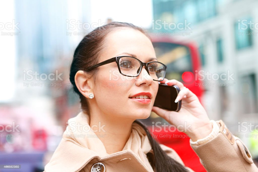 Young girl in London having a phone call stock photo