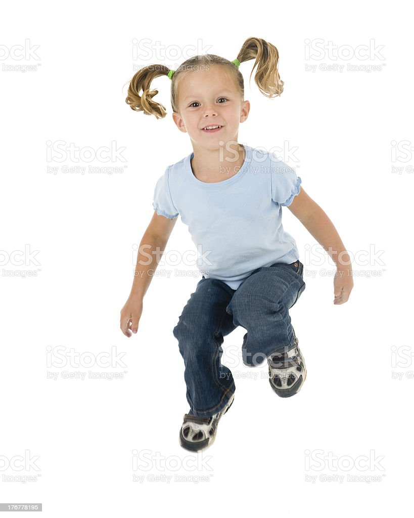 Young Girl in Mid-Air with Pigtails Flying royalty-free stock photo