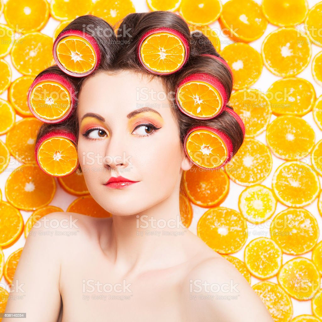 Young girl in orange fruit image stock photo