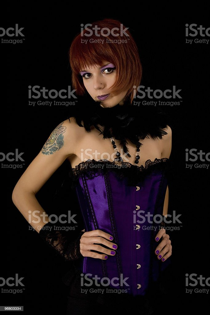Young girl in purple corset royalty-free stock photo