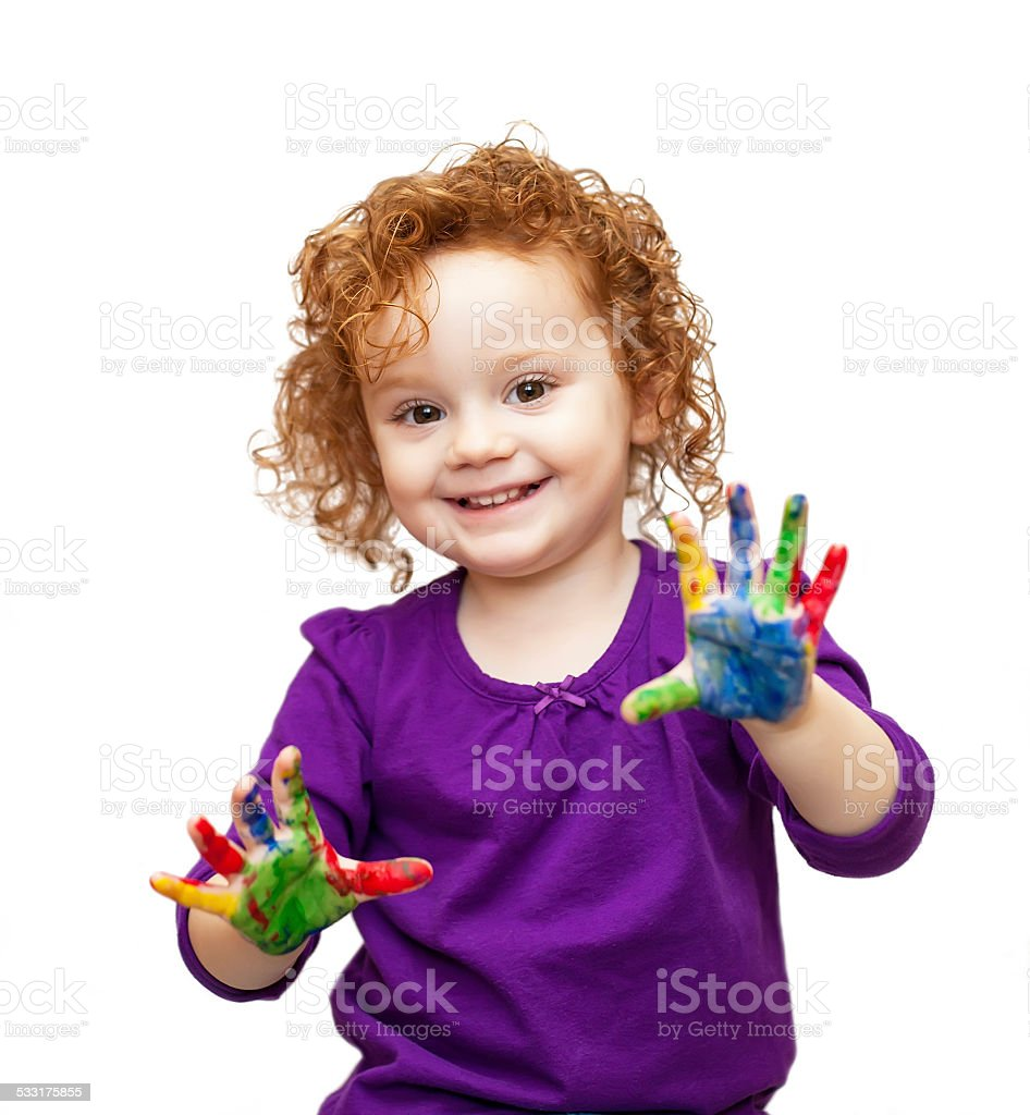 Young Girl in Purple With Paint on Her Hands stock photo