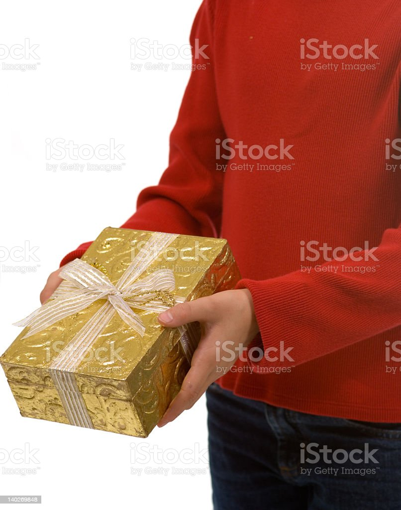 Young girl in red with gold Christmas present stock photo