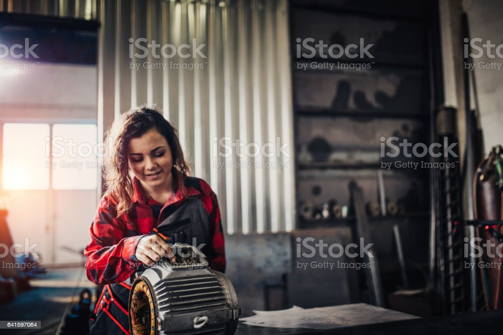 Young girl in repair shop stock photo