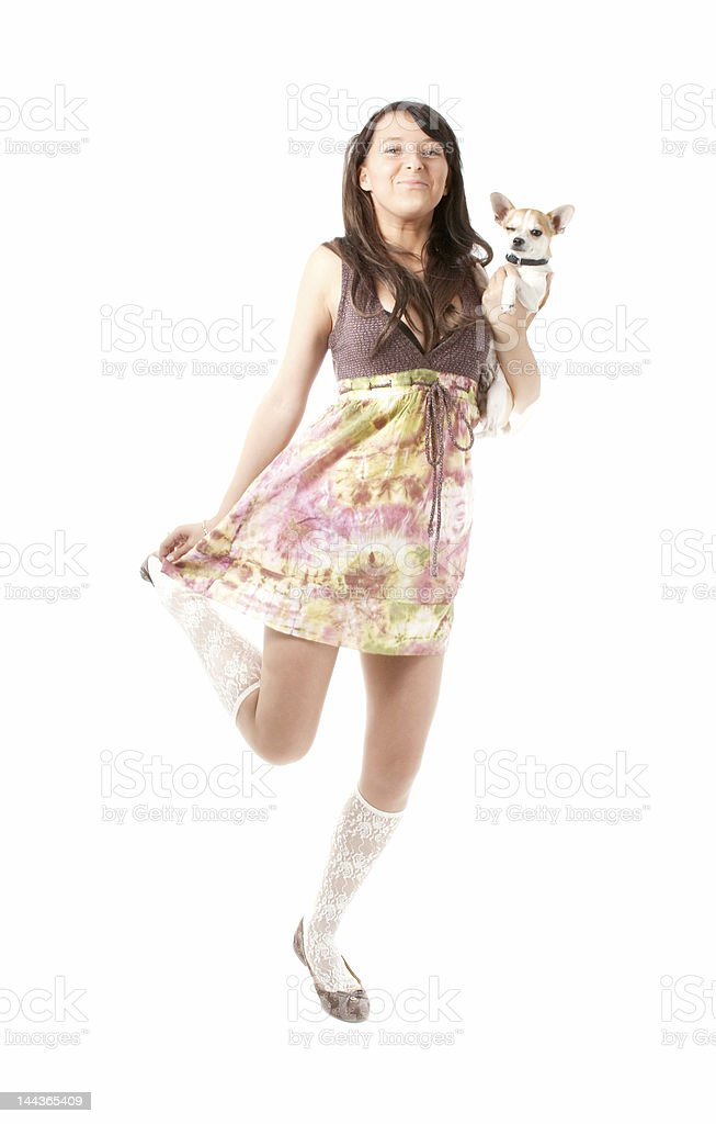 Young girl in skirt and ballet slippers holding chihuahua royalty-free stock photo