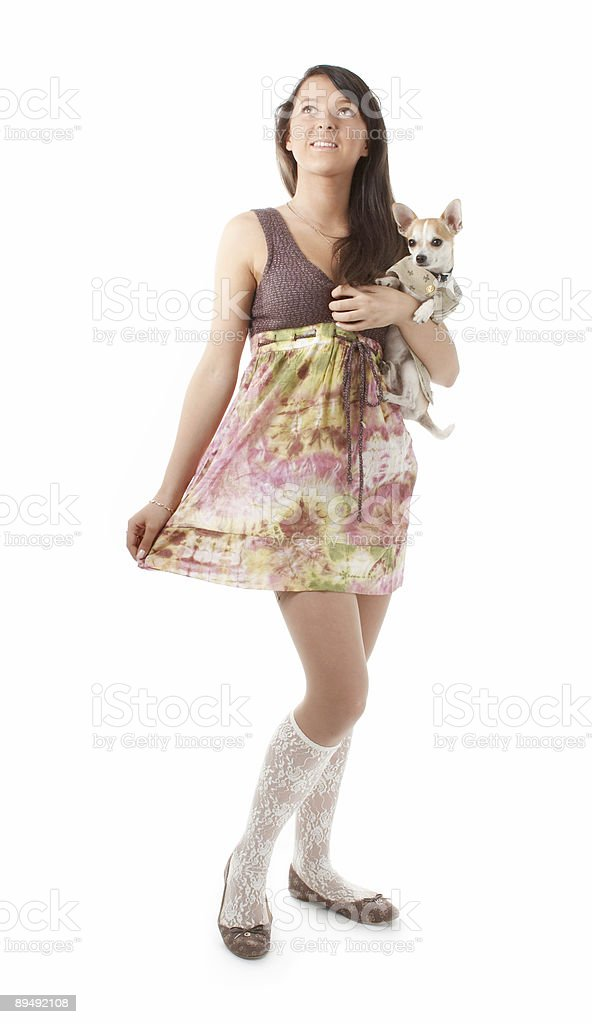 Young girl in skirt and ballet slippers with chihuahua royalty-free stock photo
