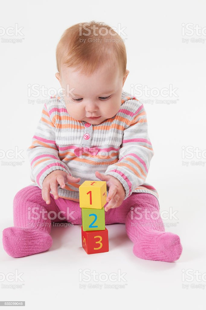 Young Girl In Studio Playing With Number Blocks stock photo