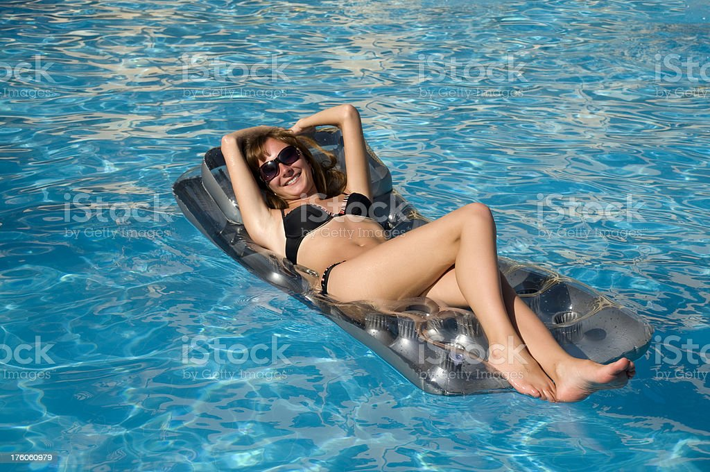 Young girl in swimming pool royalty-free stock photo