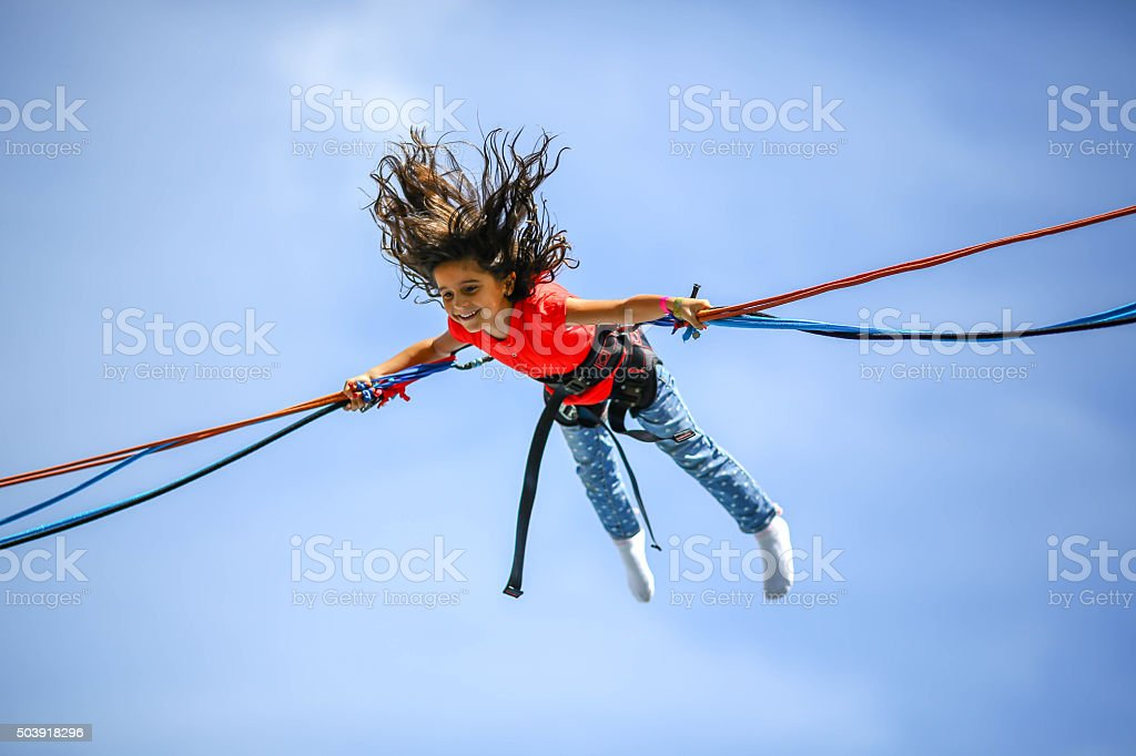 Young girl in the air stock photo