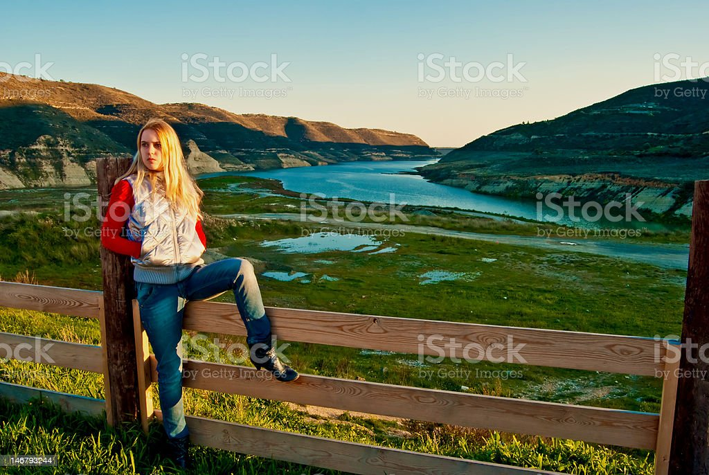 young girl in the mountains stock photo