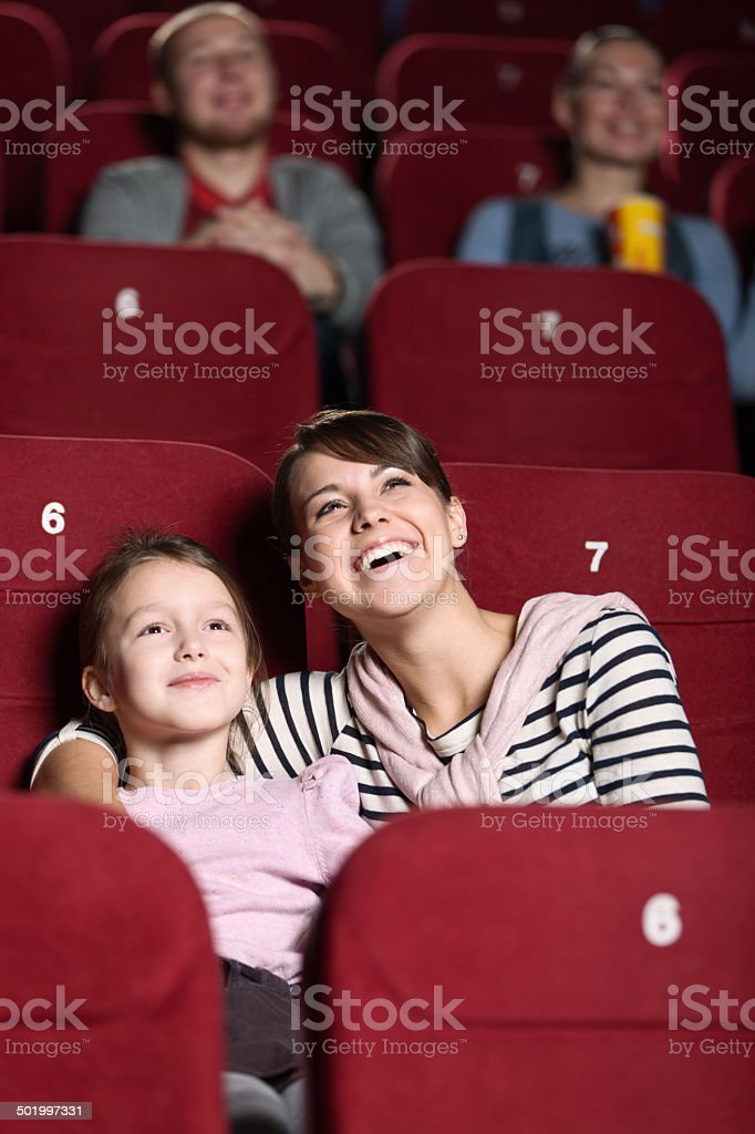 Young girl in the movie stock photo