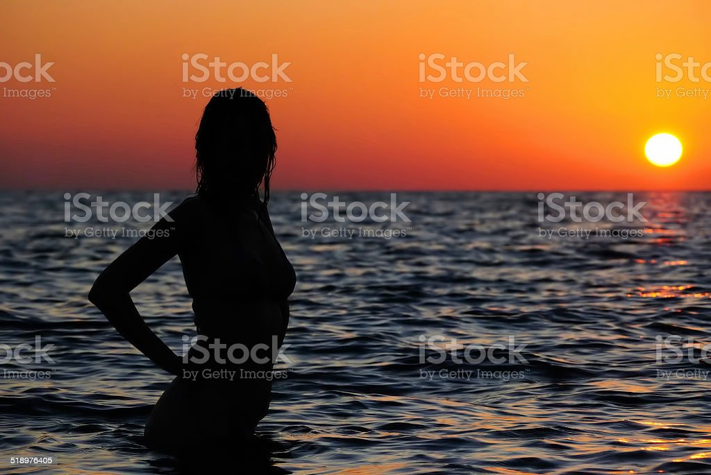 Young girl in the sea stock photo