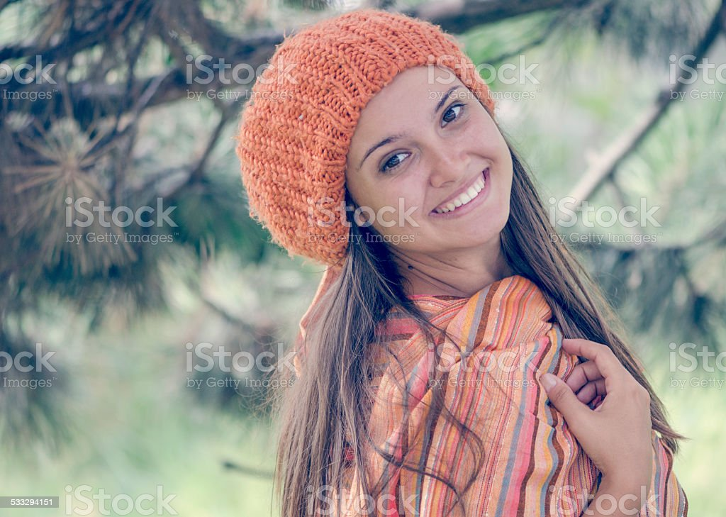 young girl in warm autumn dress standing outdoor, posing stock photo