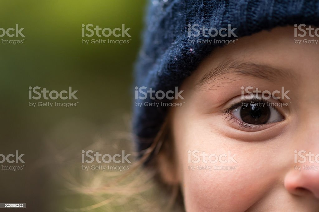 Young girl in warm blue wool hat stock photo