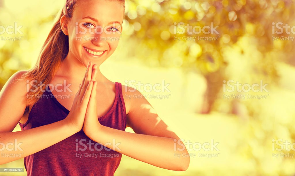 Young girl in yoga pose. stock photo