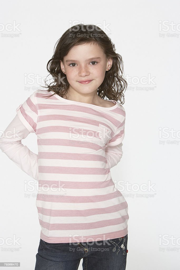 Young girl indoors looking at camera stock photo