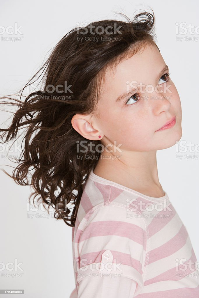 Young girl indoors looking outside stock photo