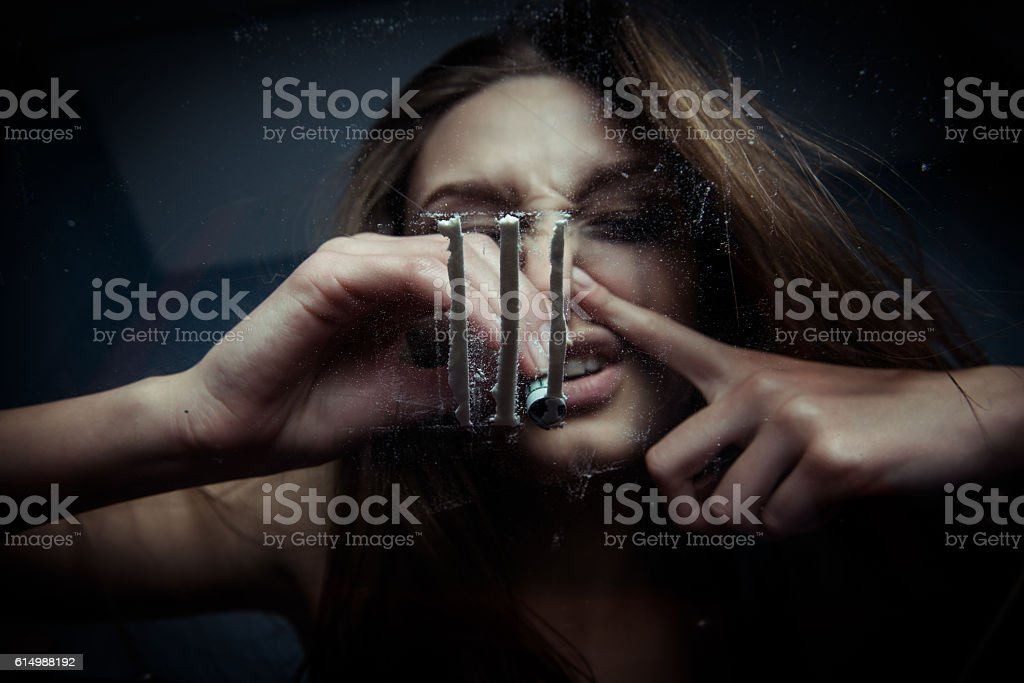 Young girl  inhales cocaine, bottom view stock photo