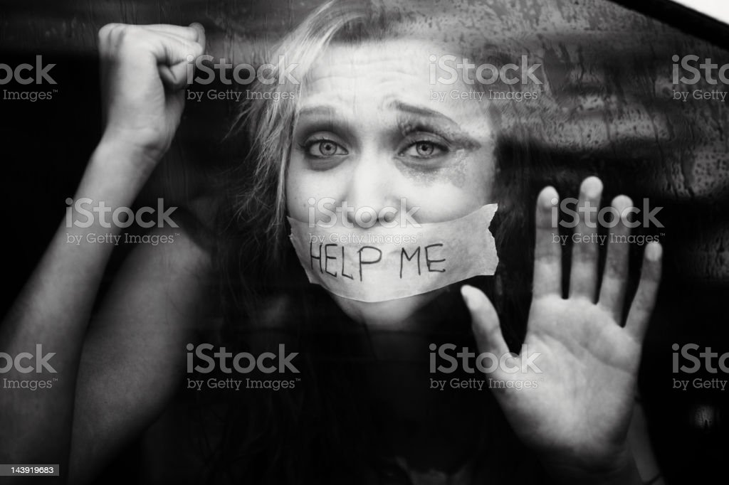 young girl is a victim of abduction stock photo