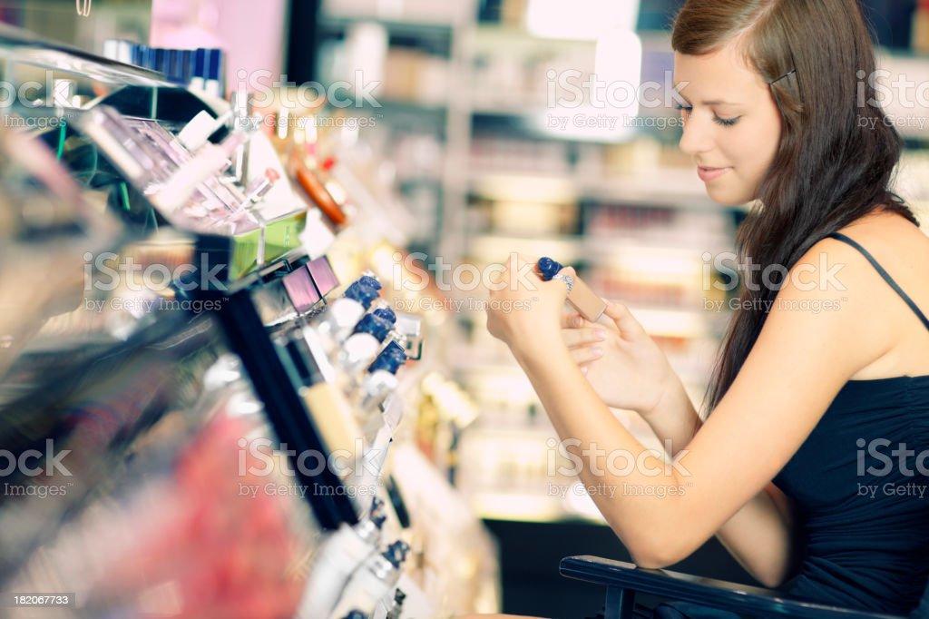 young girl is  buying  cosmetics stock photo