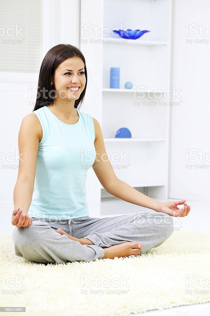 Young girl is doing yoga exercises at home royalty-free stock photo