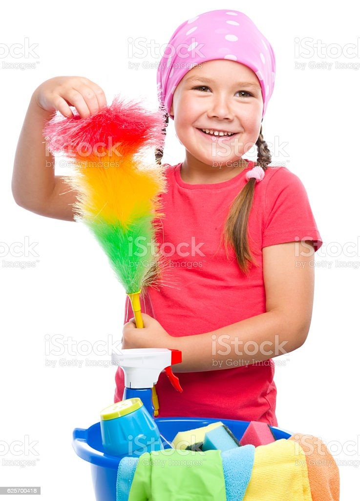 Young girl is dressed as a cleaning maid stock photo