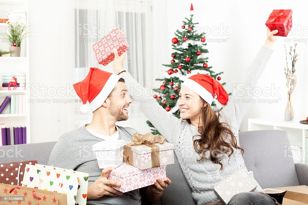 young girl is happy about the christmas gifts stock photo