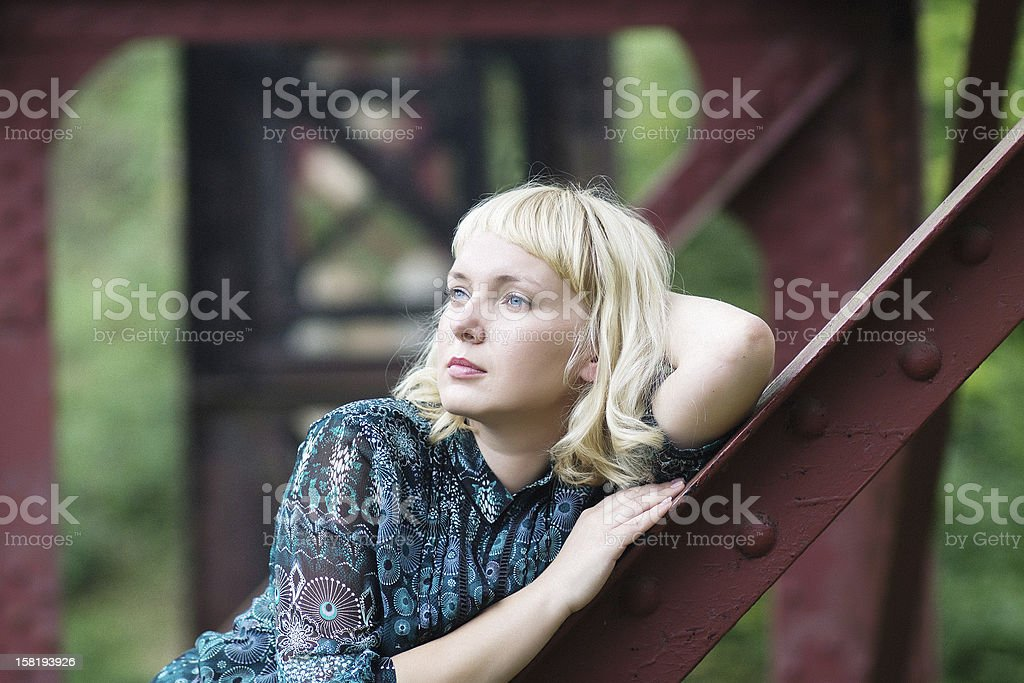 young  girl is  on bridge bearing royalty-free stock photo
