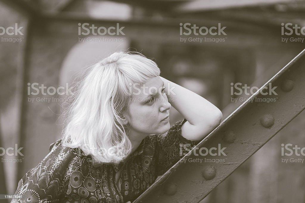 young  girl is  on bridge bearing royalty-free stock photo