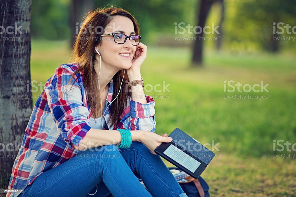 Young girl is reading from her ebook stock photo