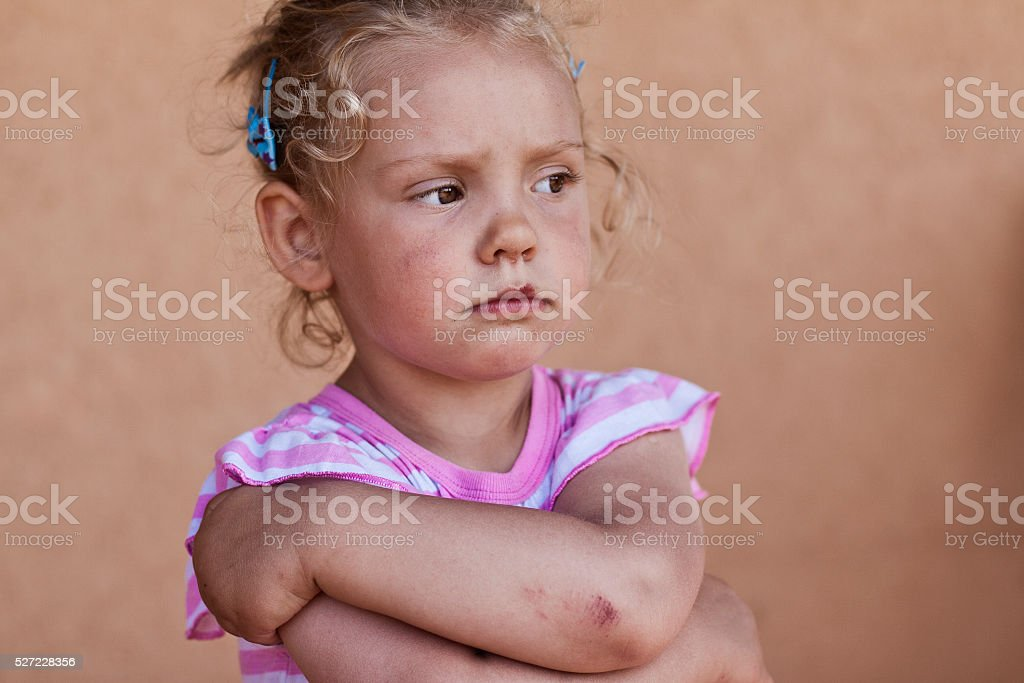 Young girl is standing with arms folded. stock photo