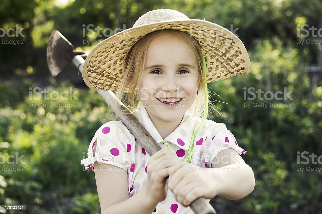 Young girl is workng in the garden royalty-free stock photo