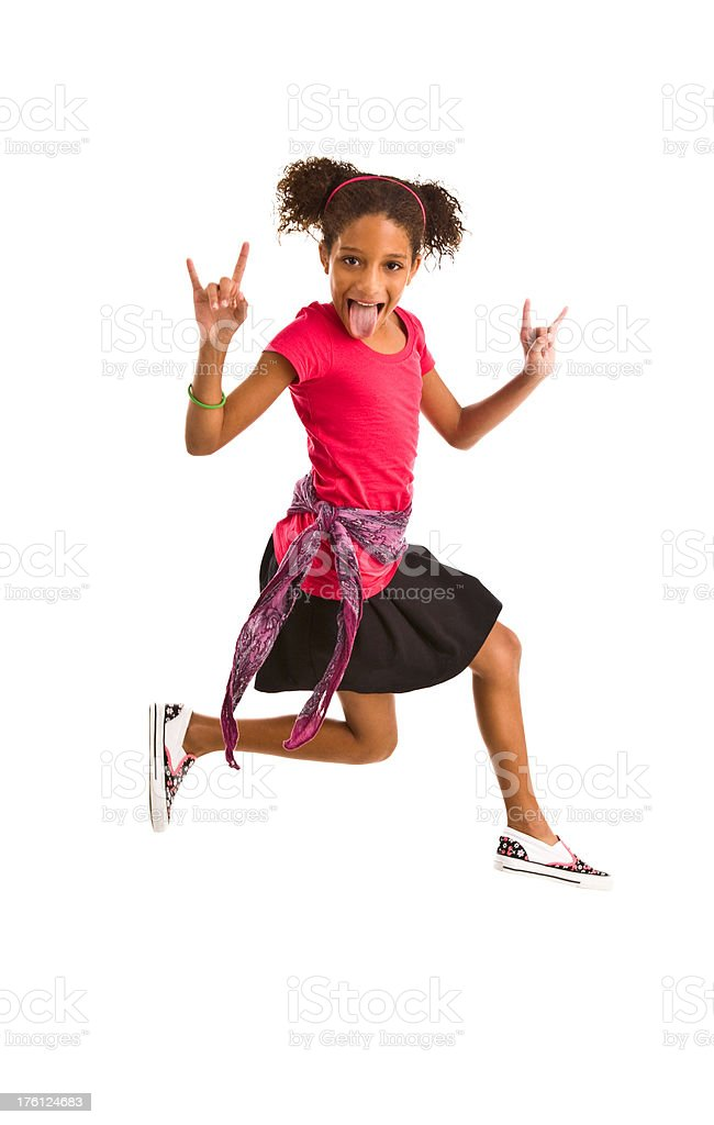 Young girl jumping in air, gesturing and making a face royalty-free stock photo