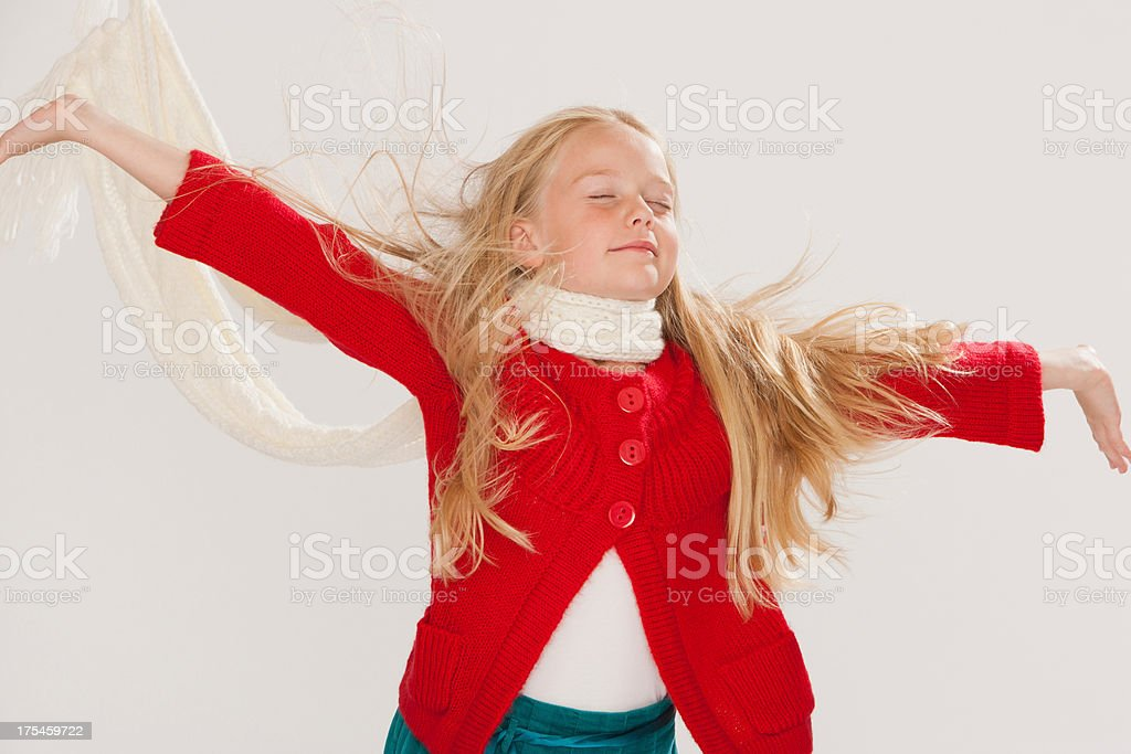 Young girl jumping indoors stock photo