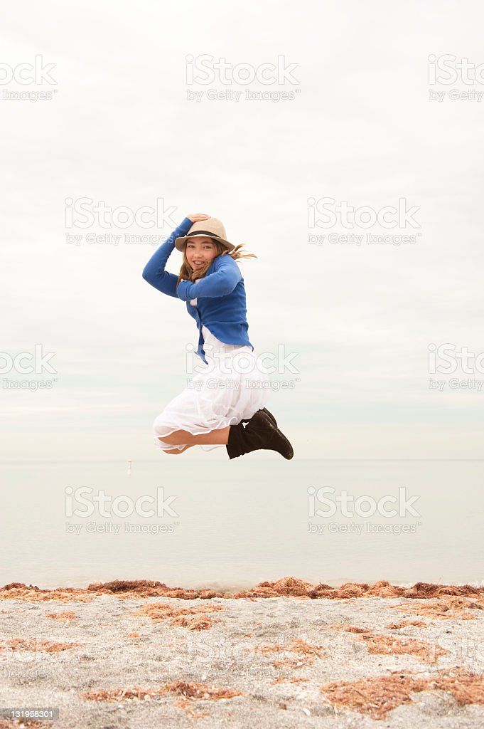 Young girl jumping on a beach serie. royalty-free stock photo