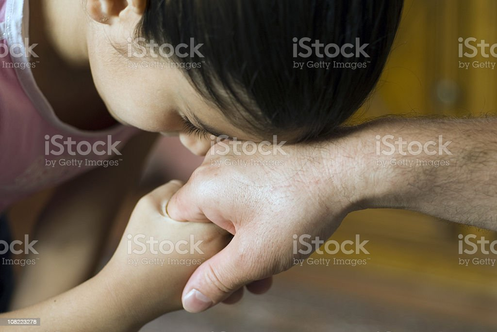 Young Girl Kissing Hand of Father, Traditional Islamic Gesture, Turkey royalty-free stock photo